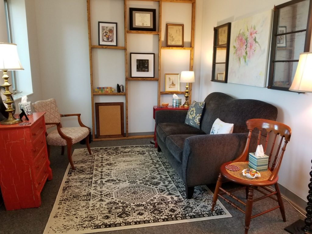 JoEllen's North St. Paul counseling office with art, chair, sofa, lamps