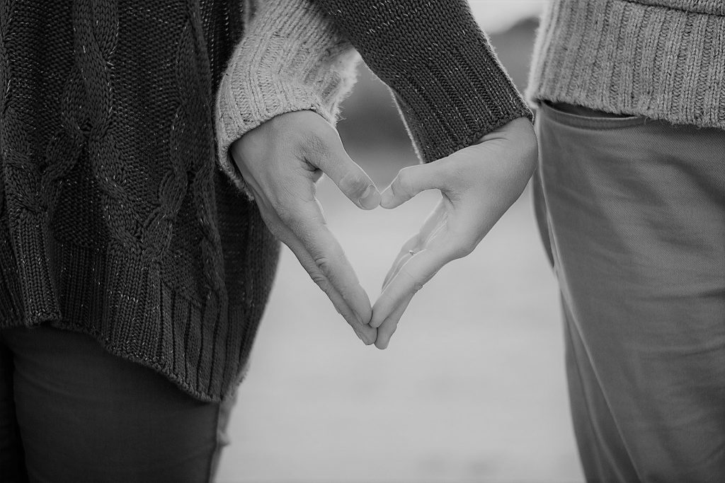 couple crossed arms to make heart with hands B&W