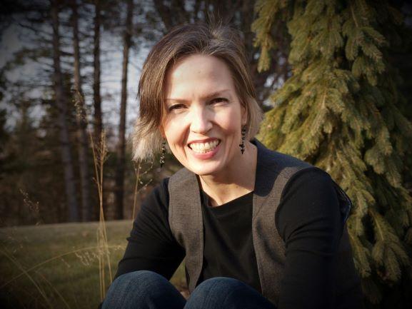 JoEllen, casual, in jeans, trees in background
