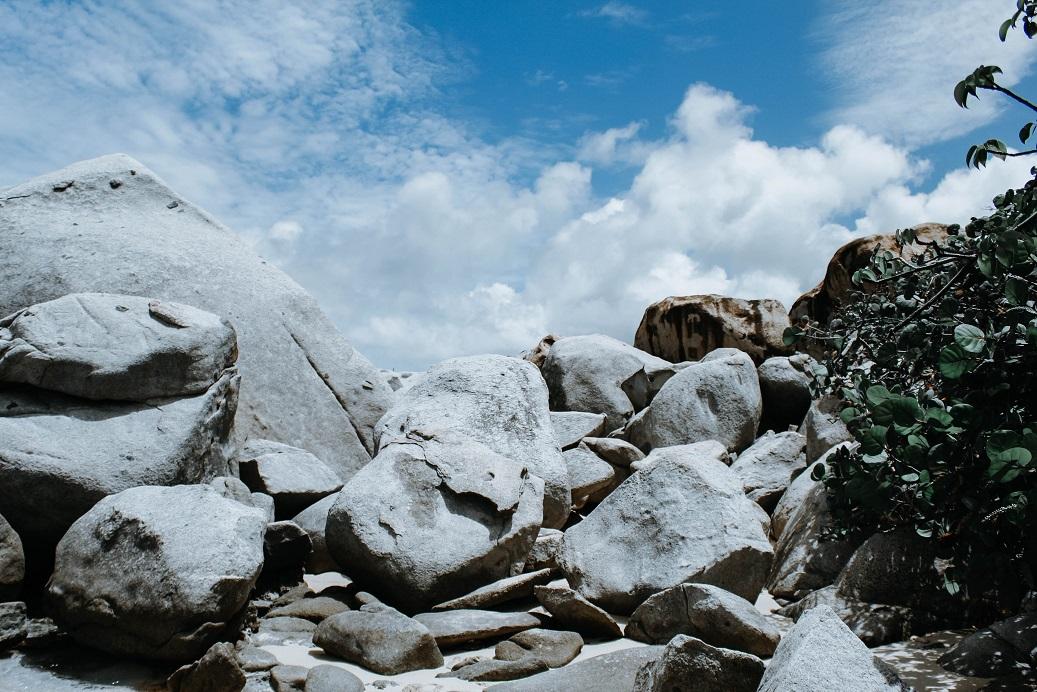 looking up boulders toward blue sky_kristen sturdivant